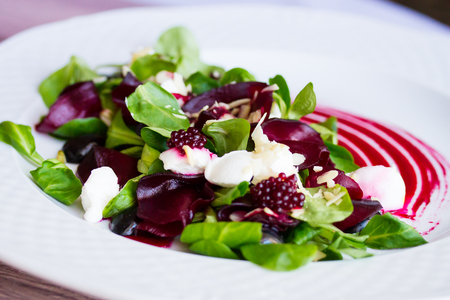 Salad of beets, lettuce and cheese Stock Photo
