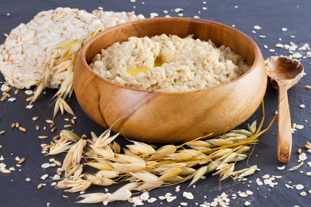 uk cuisine: Oatmeal in a wooden bowl and ears of corn oat