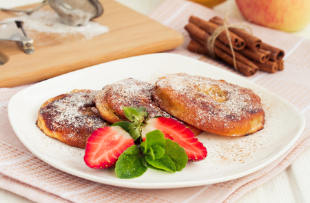 powdered: Apple rings dipped in batter with cinnamon and powdered sugar