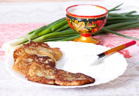 Potato flapjacks with sour cream and leek Stock Photo