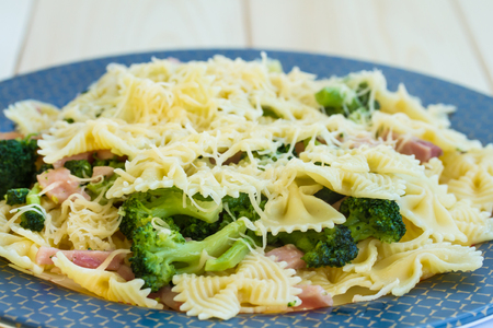 baked meat: Pasta with ham, broccoli and cheese Stock Photo