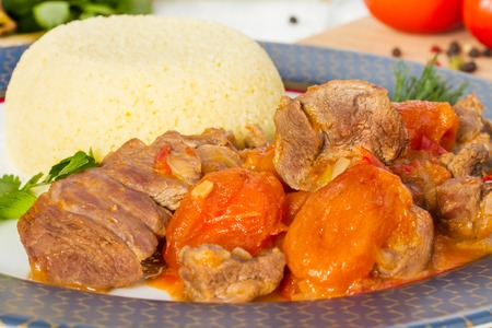 rich flavor: Lunch Time - Lamb stew in Arabic with vegetables and dried apricots. Stock Photo