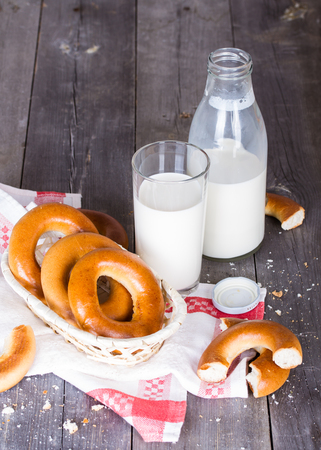 baranka: Milk and bagels on a wooden table Stock Photo