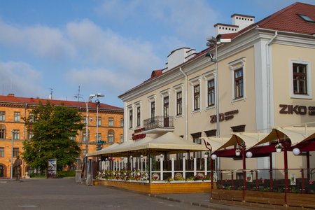 minsk: MINSK, BELARUS - JULY 30: Outdoor cafe on Liberty Square opposite the Town Hall on July 30, 2016 in Minsk. Editorial