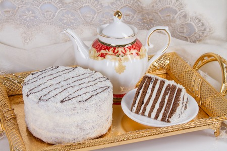 Cake with chocolate shortcakes, stuffed with whipped cream and a dusting of coconut Stock Photo