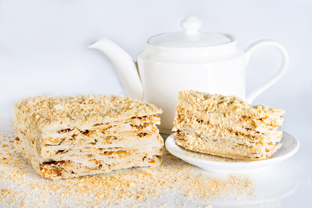 Delicious cake of puff pastry with layers of boiled condensed milk