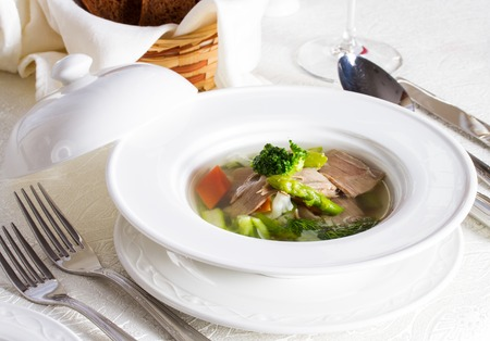 Vegetable soup with pieces of meat and bread Stock Photo