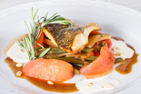 Pike perch baked with vegetables and sprig of rosemary