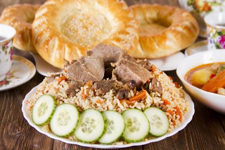 Uzbek national cuisine - pilaf and flat cakes Stock Photo