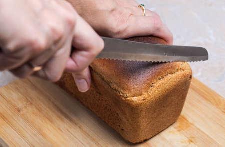 brown: Cutting brown bread Stock Photo
