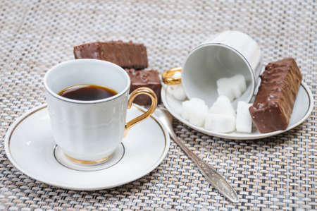 energizing: Coffee in a Cup with sugar cubes and chocolate waffles Stock Photo