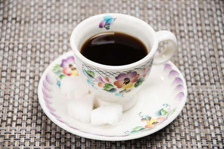 invigorating: Coffee in a Cup with sugar cubes Stock Photo