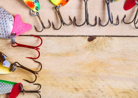 zeal: Background of the fishing lures on wooden boards