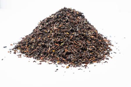 unpressed: A bunch of dry black unpressed tea with flavors isolated on a white background