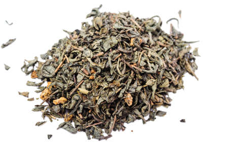 unpressed: A bunch of dry green unpressed tea with flavors isolated on a white background