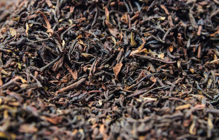 admixture: Background of dry black unpressed tea with flavors