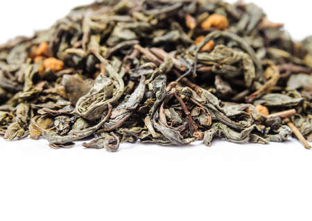 admixture: A bunch of dry green unpressed tea with flavors isolated on a white background