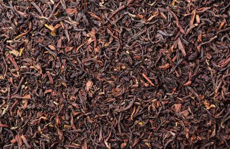 unpressed: Background of dry black unpressed tea with flavors
