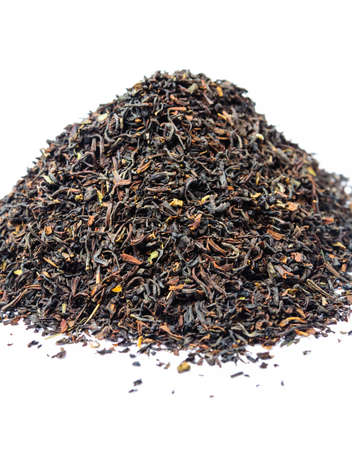 admixture: A bunch of dry black unpressed tea with flavors isolated on a white background