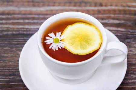 chamomile tea: Chamomile tea with lemon in a white cup