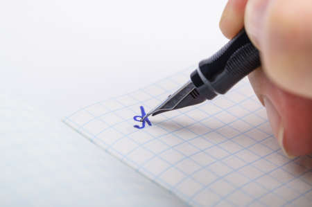 legal pad: Writing feather ink pen letter A in a notebook in a cage Stock Photo