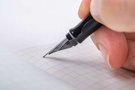 memorize: Writing feather ink pen letter A in a notebook in a cage Stock Photo