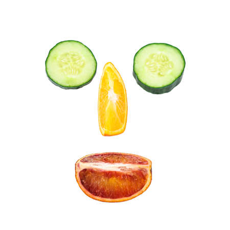 embody: Face lined with orange  and cucumber slices isolated on white background
