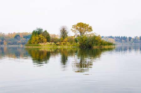 turbid: Raspberry island on lake Senezh in Solnechnogorsk fall in the fog in calm weather. Autumn water landscape