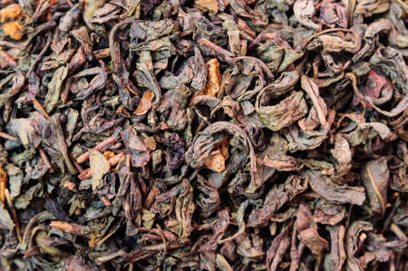 admixture: Background of dry green unpressed tea with flavors