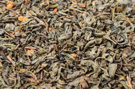 unpressed: Background of dry green unpressed tea with flavors