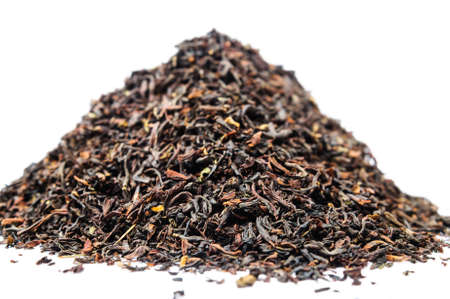 A bunch of dry black unpressed tea with flavors isolated on a white background