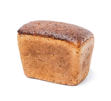 A loaf of black rye-wheat unleavened bread isolated on white background Stock Photo