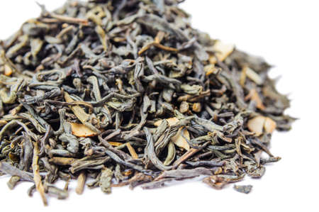 A bunch of dry green unpressed tea with flavors isolated on a white background