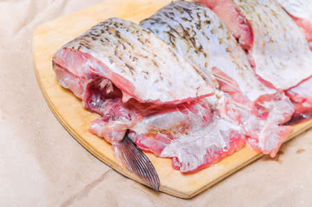 Raw fish  ide cut into pieces for cooking