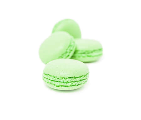 Colorful traditional french dessert macarons isolated on white background