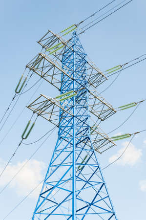 High voltage electric tower. New painted power line masts 版權商用圖片