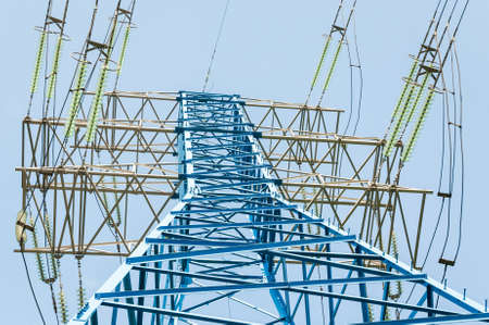 High voltage electric tower. New painted power line masts Stockfoto