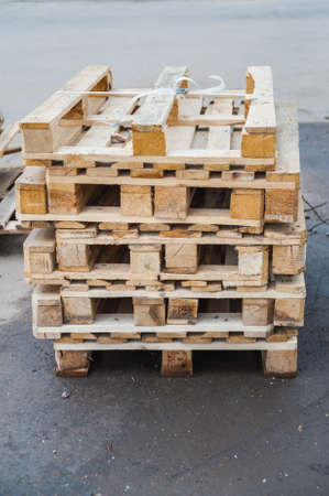 Wooden pallets stacked one on another in a pile outdoor