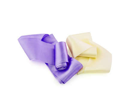 Two rolls of satin ribbon of violet and pale yellow color isolated on white background Stockfoto