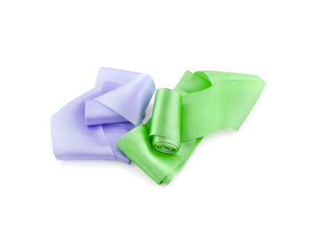 Two rolls of satin ribbon of lilac and green color isolated on white background