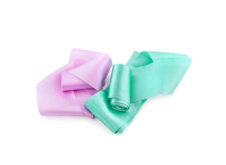 Two rolls of satin ribbon of pink and turquoise color isolated on white background
