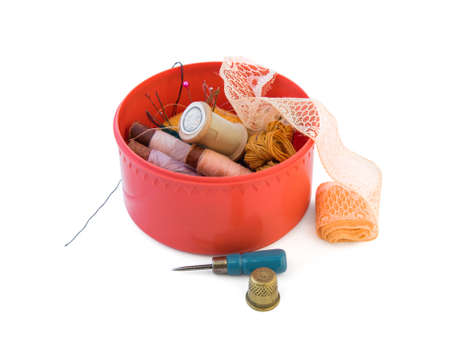 Old plastic red round box with threads and needles, lace rolled tape, awl and thimble