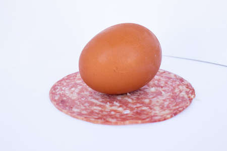 egg and salami sliced composition