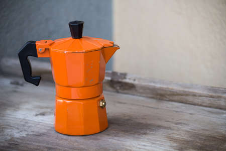 coffee pot, orange coffee machine Stock Photo