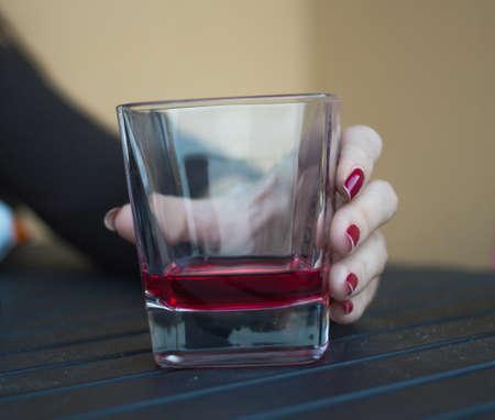 liquor girl: holding drink