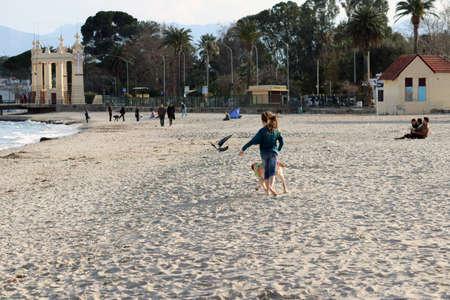 child running with dog, mondello, sicily