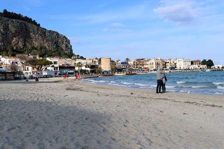 couple kisses on the beach, sicily, palermo