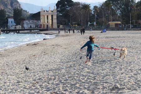 child running with dog Stock Photo