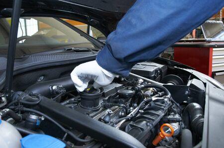 mechanic repairs a car in a garage Stock Photo