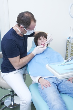 mouth cavity: boy during a dental visit. doctors clinic